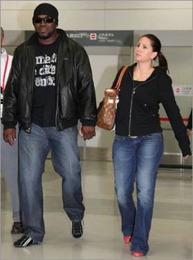 David Ortiz (left) walks through the terminal after Friday's arrival.