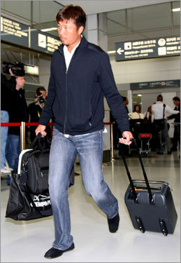 Hideki Okajima arrives in his native Japan.