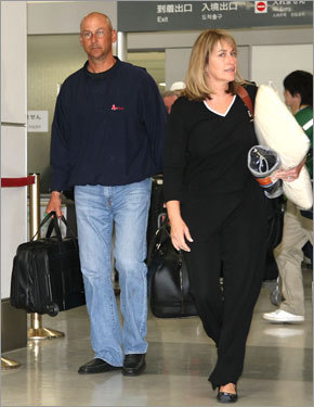 One day after the dispute over coaches pay for the Japan trip was settled, Red Sox manager Terry Francona (left) arrives in Tokyo with his wife, Jacque.