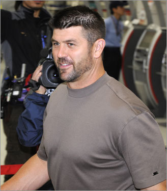 Sox captain and catcher Jason Varitek arrives at Tokyo's Hanada International airport one day after speaking out on behalf of the Red Sox coaches, who settled their pay dispute with MLB for the Japan trip.