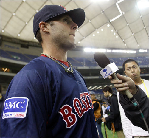 Red Sox second baseman Dustin Pedroia does an interview during the team's first full day in Japan.