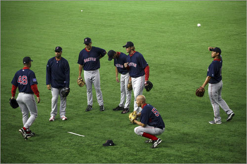 Red Sox players gather during the team's practice at Tokyo Dome.