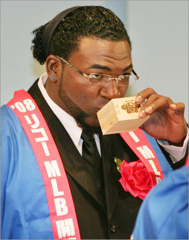 Red Sox DH David Ortiz enjoys Japanese sake during a welcome party in Tokyo on Friday.