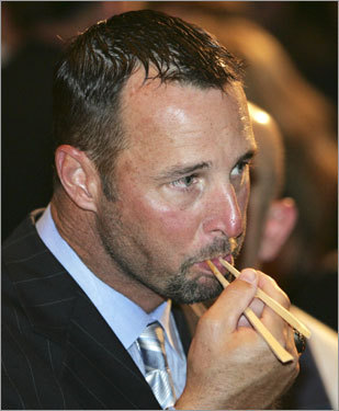 Red Sox pitcher Tim Wakefield uses chopsticks during a welcome party.