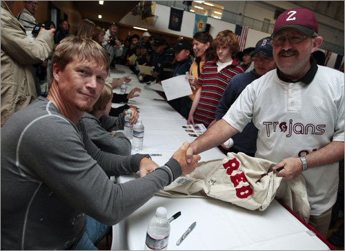 Red Sox pitcher Mike Timlin (left) poses with a fan during a visit to US Army Camp Zama.