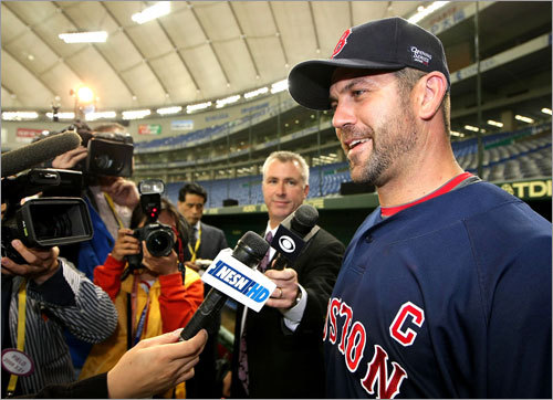 Sox catcher Jason Varitek speaks to the media at the Tokyo Dome.