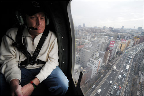 Red Sox pitcher Curt Schilling rides in a helicopter en route to US Army Camp Zama, west of Tokyo, on Friday.