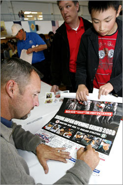 Red Sox pitcher Tim Wakefield signs autographs for fans during a visit to Camp Zama.
