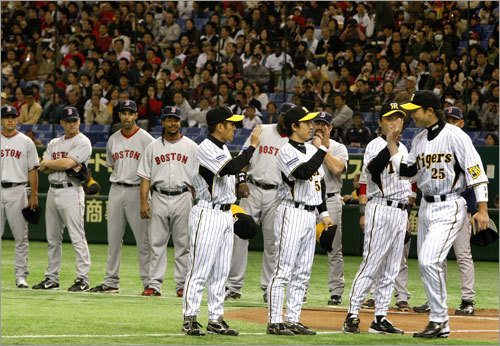 Red Sox and Hanshin Tiger players were introduced at the start of the game.