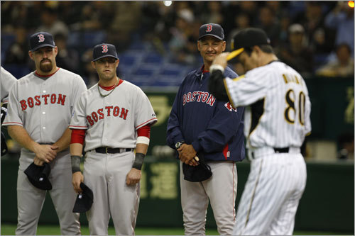Hanshin Tiger Manager Akinobu Okada tipped his cap to the Red Sox Saturday. The Tigers were the first exhibition opponent for the Red Sox in Japan.