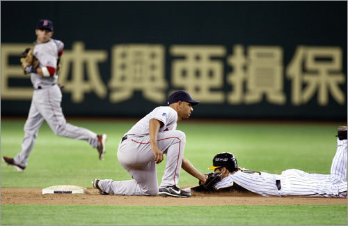 Alex Cora slapped the tag on this Hanshin Tiger trying to steal second, with room to spare.