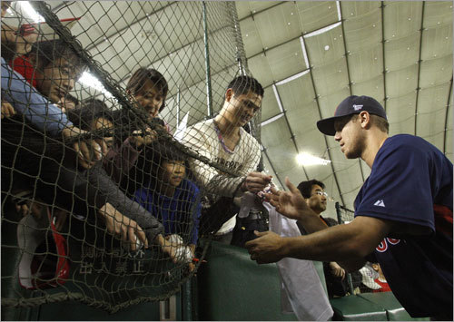 Red Sox pitcher Jonathan Papelbon signed autographs.
