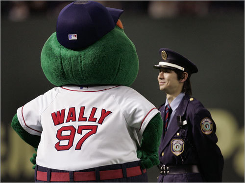 Wally the Green Monster succeeds in getting this security officer to smile.