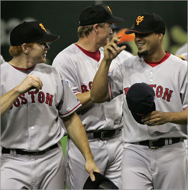 Bobby Kielty, Mike Timlin, and Manny Delcarmen tried. on their Yomiuri Giants hats.