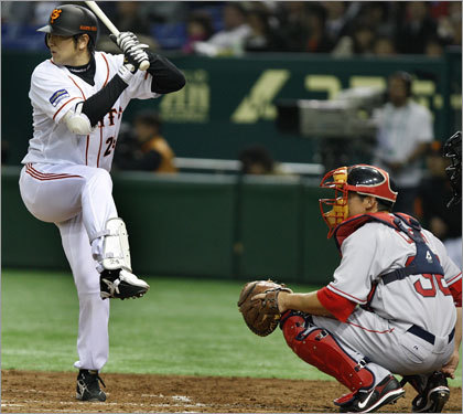 Yomiuri Giant Yoshinobu Takahashi shows off a rather unusual batting stance.
