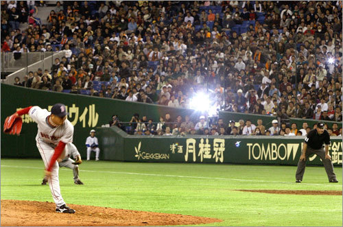 Flashbulbs went off when Hideki Okajima came in relief. Okajima used to play for the Giants.