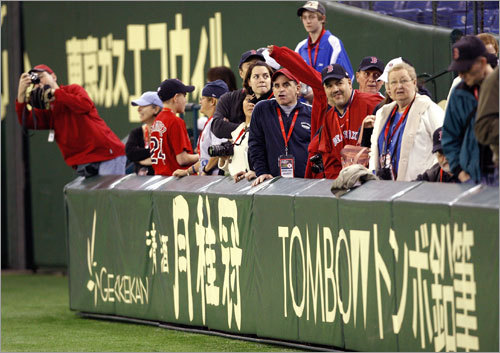 A familiar sight: Red Sox fans swarmed the sidelines, trying to get a glimpse of their favorite players.