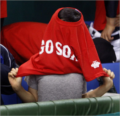 This young Japanese player had trouble getting into his uniform for the day.