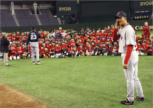 Hideki Okajima could hardly hear over the din of a gaggle of young Japanese baseball players.