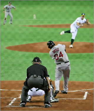 Joe Blanton of the Athletics pitches against Sox DH David Ortiz at the Tokyo Dome.