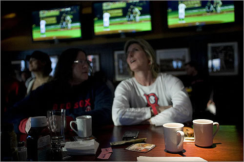 Karen Shanahan (left) and Cathi Lyons enjoyed their third cup of coffee at the Cask 'n Flagon with dozens of Red Sox fans who rose early for the 6:07 a.m. local start time.