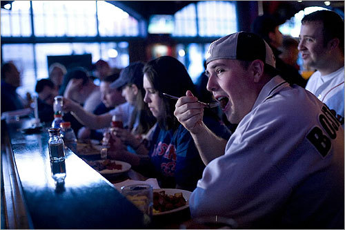 After a 90-minute wait, Adam Storey took a bite of his home fries while keeping an eye on the Red Sox. 'I just wish I had a beer,' he said.