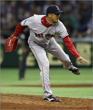 Red Sox relief pitcher Hideki Okajima pitches against the Athletics in the 9th inning.