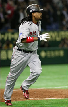 Manny Ramirez watches his two-run double in the 10th inning that gave the Red Sox a 6-4 lead over the A's.