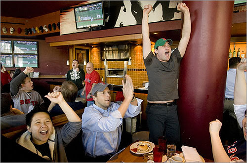 Sherry Cheuk, Ken Sommers, Gregory Mullen, and Liz Morrison celebrated at Game On as Manny Ramirez hit a two-run double in the top of the 10th inning, putting the Red Sox ahead of the Oakland A's in their season opener.