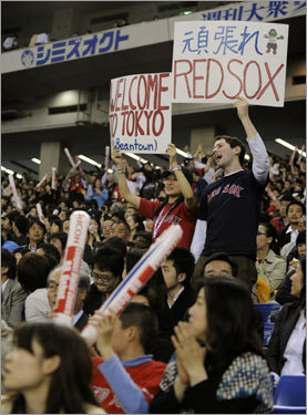 Fans of Red Sox cheer for the defending world champs during the Opening Day game against Oakland. The Red Sox edged the Athletics 6-5 in a nail-biting, extra-inning game.