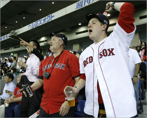 Red Sox fans cheer the team in the eighth inning.