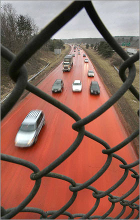 As viewed from the Route 119 overpass, Interstate 495 northbound lanes in Littleton, MA were dyed orange in 2007 after a spill of pigment that's used to color bark mulch.