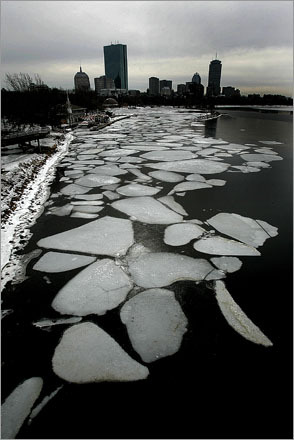 Ice floes line the banks of the Charles River in Boston near the Community Boat House in 2007.