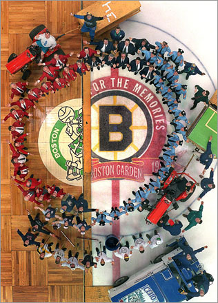 Before one of the last Celtics games at the old Boston Garden in 1995, the Garden ushers, bull gang, security, and ice maintainence personnel pose with the Celtics' parquet court and the Bruins' ice.