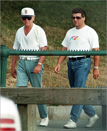 Serial killer Whitey Bulger, left, and long-time associate Kevin Weeks on a 1994 walk around Castle Island. This is the last photo taken of Bulger before he fled.