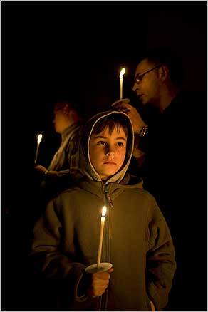 Wesley Richardson, 8, of Newton, participated in the 'Rise Up! A Soulful Easter Vigil' which included the lighting of the Paschal candle and an opening chant, 'Be still and know that I am God,' at St. Paul's Episcopal Cathedral in Boston.