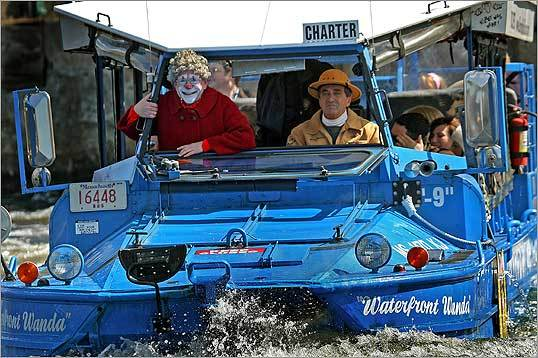 Boston Duck Tours are back for Spring as one got underway on the Charles River. It had some help from GRANDMA Big Apple Circus and tour driver Dennis Myles, aka RAY BEEZ, on the left.