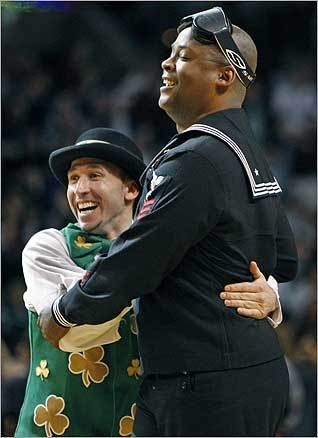 US troops were treated to tickets to the Celtics-76ers game last week. Left, a serviceman who won a half-time contest was congratulated by Celtics mascot 'Lucky' as the crowd cheered. The Seats for Soldiers donations were a product of a unique collaborative effort among the Boston Celtics, Celtics season ticket holders and fans that purchased tickets for the March 24 home game.