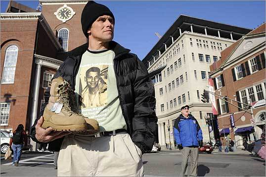 Carlos Arredondo, age 42, of Roslindale, MA, held a pair of military boots belonging to his late son Lance Corporal Alexander Arredondo, USMC. Alexander was killed in Najaf, Iraq on August, 25, 2004 and was the 974th US military death in Iraq. Carlos joined representatives of United for Justice with Peace as they held a public commemoration at Boston Common for the 4,000th US military death in Iraq.