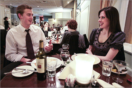 Andrew Boyink, 27, and girlfriend Renee Glowacki, 24, enjoy a dinner at Laurel Grill and Bar in Boston.