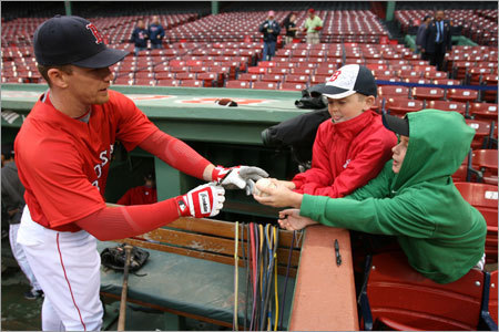 Many fans find it advantageous to seek out autographs immediately after the gates open by the dugouts, where players like J.D. Drew have a little extra time to sign for them.