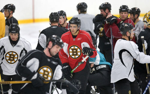 The Bruins' Patrice Bergeron (center, in red non-contact jersey) is working his way back after suffering a concussion and broken nose. It's been a long, difficult road for Bergeron. Concussions are brain injuries caused when the soft tissue of the brain slams into the skull. This can cause memory loss, fatigue, and depression, perhaps even permanently.