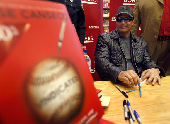 Retired baseball player Jose Canseco at the Borders Books in Boston's Downtown Crossing signing his new book, Vindicated.