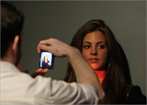 Gina Ribeiro of Somerville posed for a photo during a casting call for the film 'The Surrogates,' which stars Bruce Willis and Rhada Mitchell. The audition was held at Felt Nightclub in Boston on March 23.