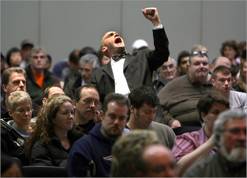 Bidder assistant Jeffrey Johnston raised his fist emphatically to signal a top bid at a property auction at the Hynes Convention Center.