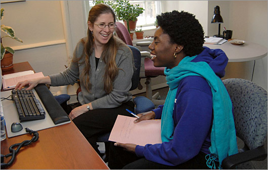 Career counselor and work-life balance consulant Debra Krumholz shares a laugh with student Eloise Green of Brooklyn, NY while viewing the alumni network at her office at Amherst College in Amherst, Mass.