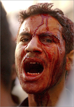 A Shiite worshipper in Karbala, Iraq screams as if in a trance while covered in blood after having cut his own scalp with a knife. He and hundreds of thousands of others are taking part in the commemoration of the assassination of the founder of the Shiite religion, Al-Hussein, who was killed in the seventh century in the city of Karbala.
