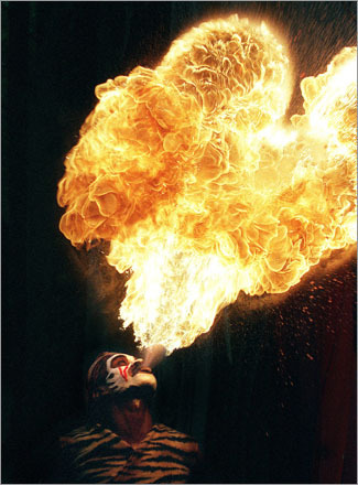 Buy this picture! Prince Akim, whose real name is Gerald Forbes Fire Dancer, performs on Columbus Day weekend at King Richard's Faire in Carver, MA in 2001.