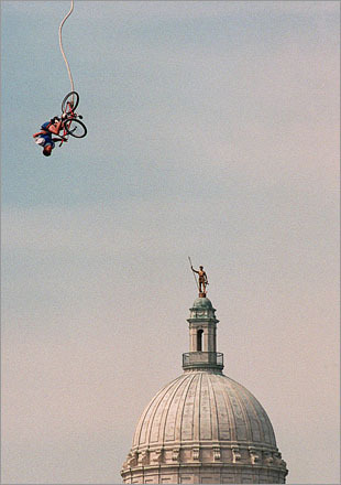 Buy this picture! A competitor in the freestyle bungy jumping contest of the 1995 Extreme Games in Providence shows his stuff with the Rhode Island Statehouse in the background.