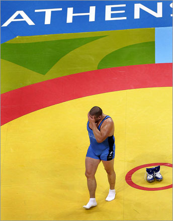 Buy photographs by Barry Chin Rulon Gardner of the USA tries to control his emotions as he walks off the mat leaving his shoes behind as a symbol of retirement from the sport. Gardner, a former gold medal winner in the 2000 Olympic games in Sydney, Australia, won a bronze medal in the men's Greco-Roman 120kg division of the 2004 Athens Olympic Summer Games.